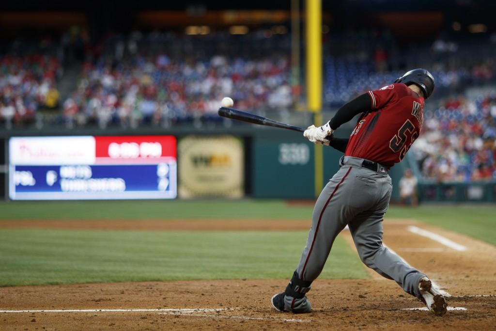 Arizona Diamondbacks' Christian Walker hits an RBI single off Philadelphia Phillies starting pitcher Zach Eflin during the fifth inning of a baseball