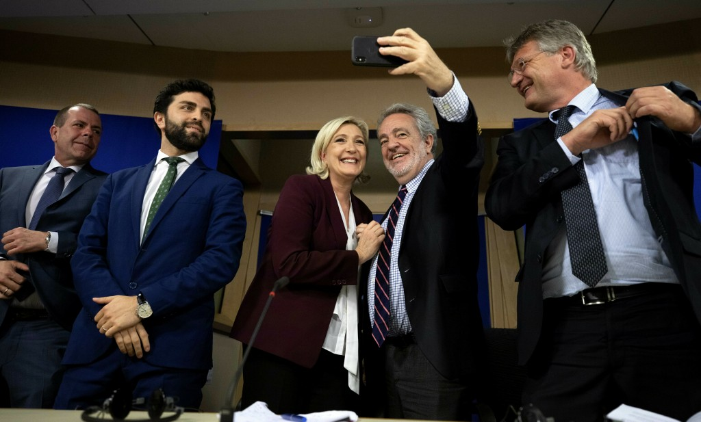 French far-right National Rally leader and MEP Marine Le Pen, center left, and Belgium's Vlaams Belang member and MEP Gerolf Annemans, center right, t