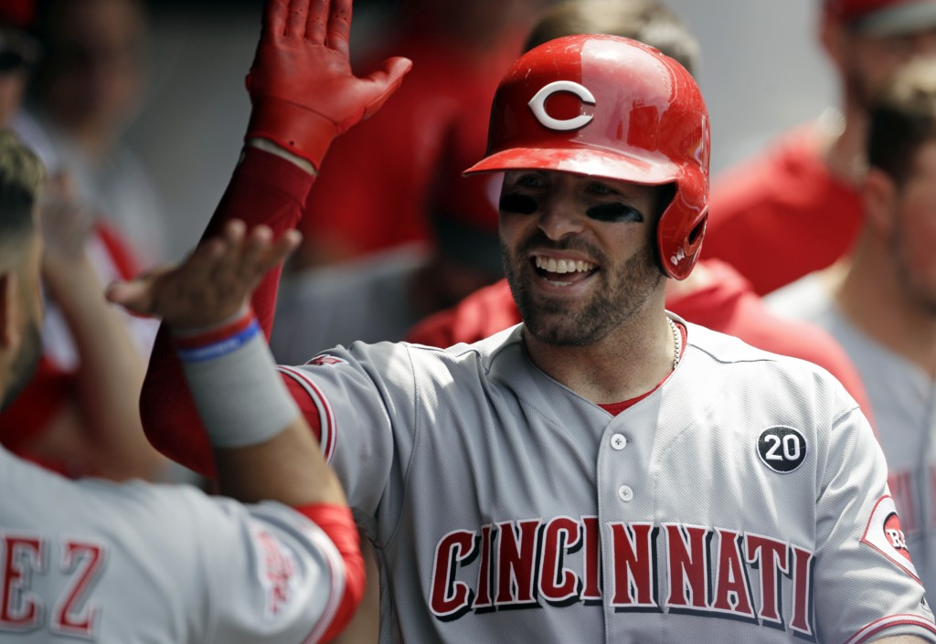 Cincinnati Reds' Curt Casali is congratulated by teammates after hitting a solo home run in the seventh inning in a baseball game against the Clevelan...
