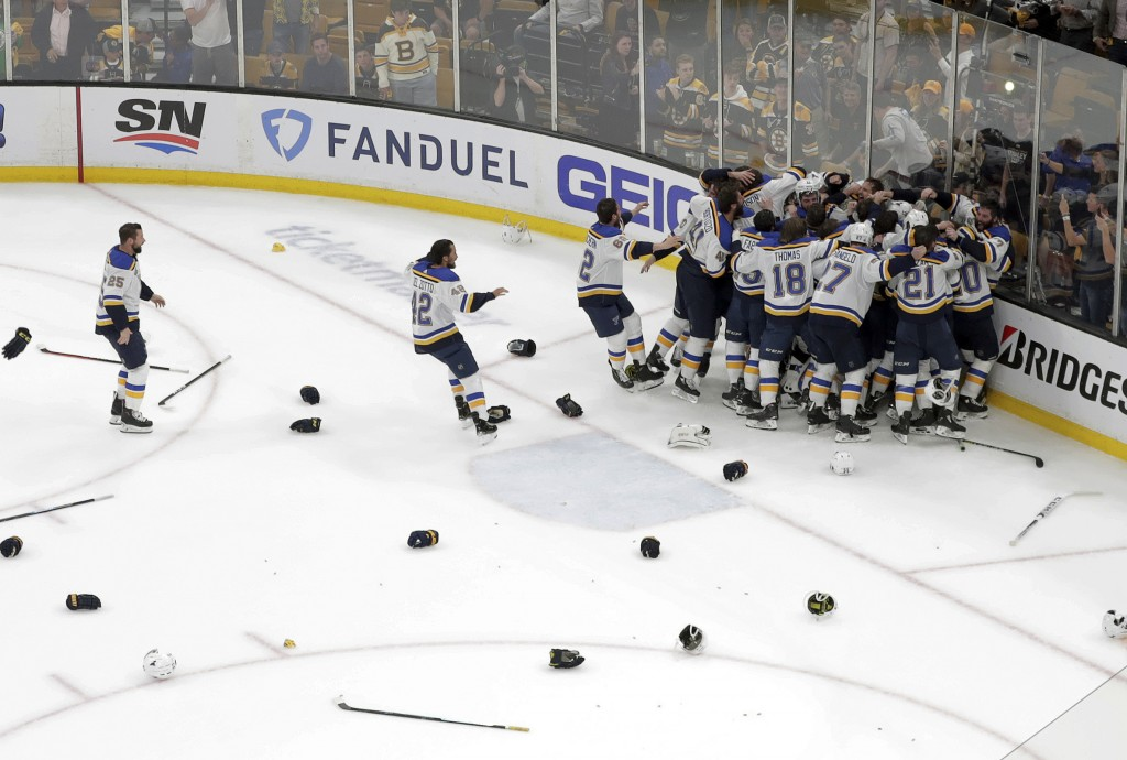 The St. Louis Blues celebrate their win over the B...