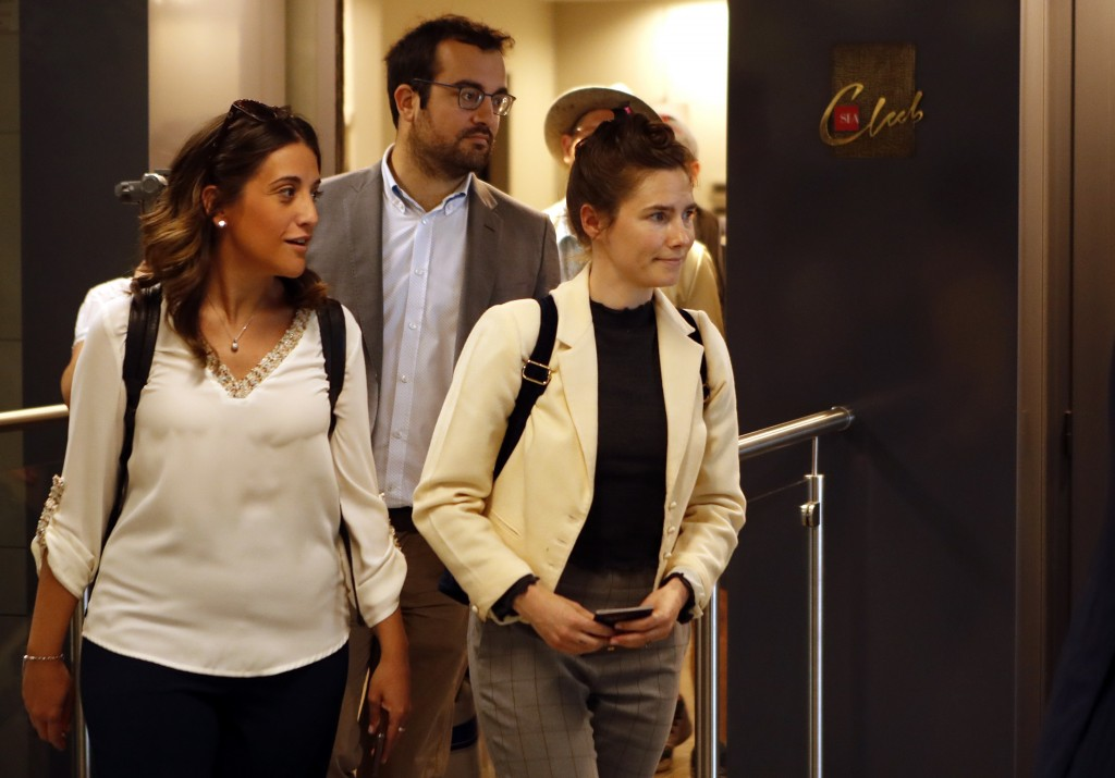Amanda Knox, right, exits the airport from a side entrance upon her arrival in Linate airport, Milan, Italy, Thursday, June 13, 2019. Knox has returne