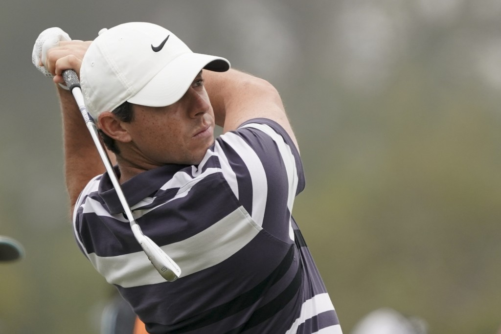 Rory McIlroy, of Northern Ireland, hits balls at t...