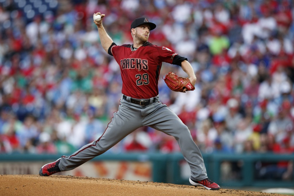 Arizona Diamondbacks' Merrill Kelly pitches during the third inning of a baseball game against the Philadelphia Phillies, Wednesday, June 12, 2019, in...