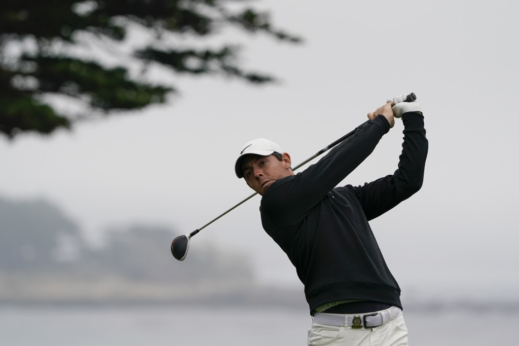 Rory McIlroy, of Northern Ireland, watches his tee shot on the 11th hole during a practice round for the U.S. Open Championship golf tournament Wednes...