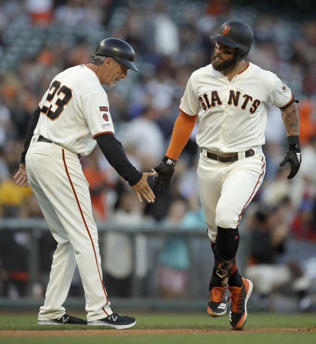 San Francisco Giants' Kevin Pillar, right, is congratulated by third base coach Ron Wotus (23) after hitting a home run off San Diego Padres' Joey Luc...