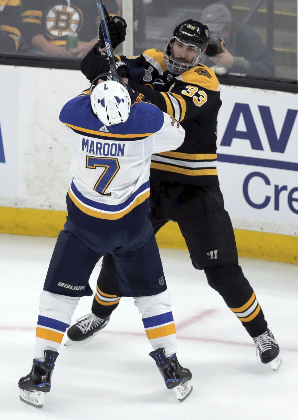 St. Louis Blues' Pat Maroon (7) tangles with Boston Bruins' Zdeno Chara, right, of Slovakia, during the first period in Game 7 of the NHL hockey Stanl...