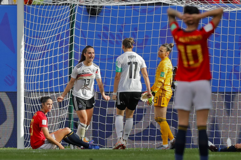 Germany's Sara Daebritz, top left, celebrates after scoring the opening goal during the Women's World Cup Group B soccer match between Spain and Germa