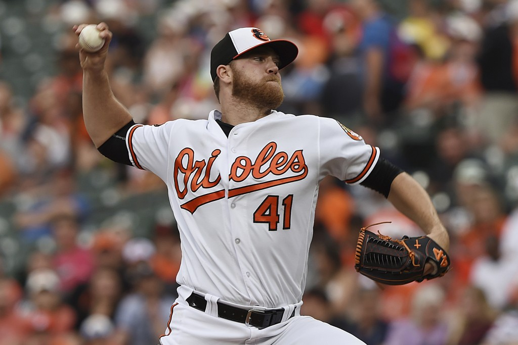 Baltimore Orioles pitcher David Hess throws to a Toronto Blue Jays batter during the first inning of a baseball game Wednesday, June 12, 2019, in Balt...