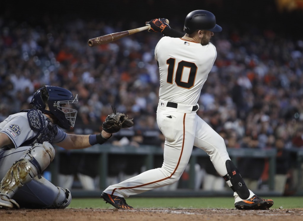 San Francisco Giants' Evan Longoria follows through on an RBI single during the fifth inning of the team's baseball game against the San Diego Padres