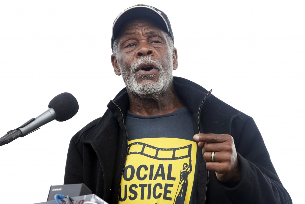 FILE - In this April 4, 2018 file photo, Actor Danny Glover speaks at the A.C.T. To End Racism rally, Won the National Mall in Washington, on the 50th...