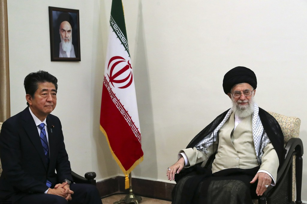 In this picture released by an official website of the office of the Iranian supreme leader, Supreme Leader Ayatollah Ali Khamenei, right, meets with