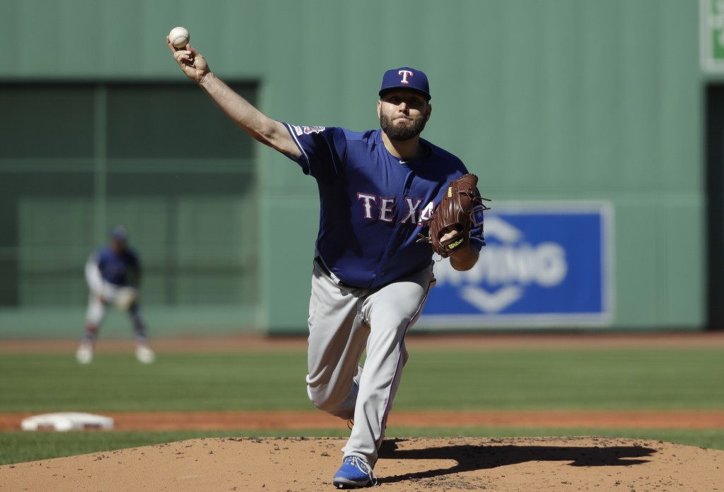 Texas Rangers starting pitcher Lance Lynn delivers to the Boston Red Sox in the first inning of a baseball game at Fenway Park, Wednesday, June 12, 20...