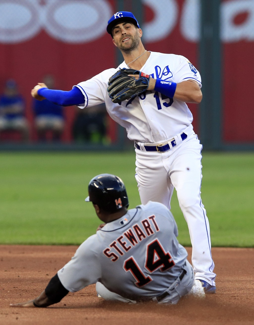 Kansas City Royals second baseman Whit Merrifield (15) forces out Detroit Tigers' Christin Stewart (14) and throws to first during the first inning of