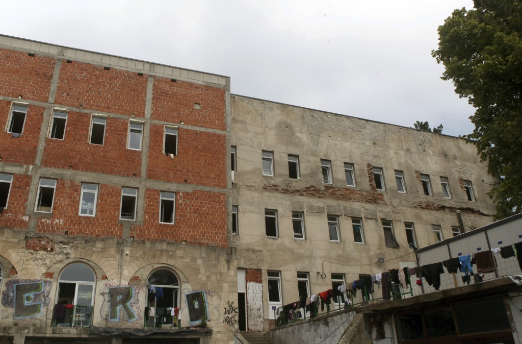 This photo taken Tuesday, June 11, 2019 shows a general view of an abandoned building, now serving as a shelter in the northwestern Bosnian town of Bi