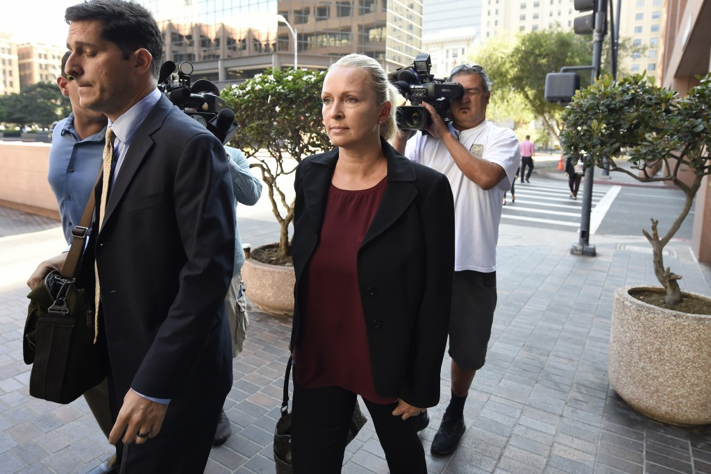 FILE - In this Thursday, Aug. 23, 2018 file photo, Margaret Hunter, center, the wife of U.S. Rep. Duncan Hunter, arrives for an arraignment hearing in