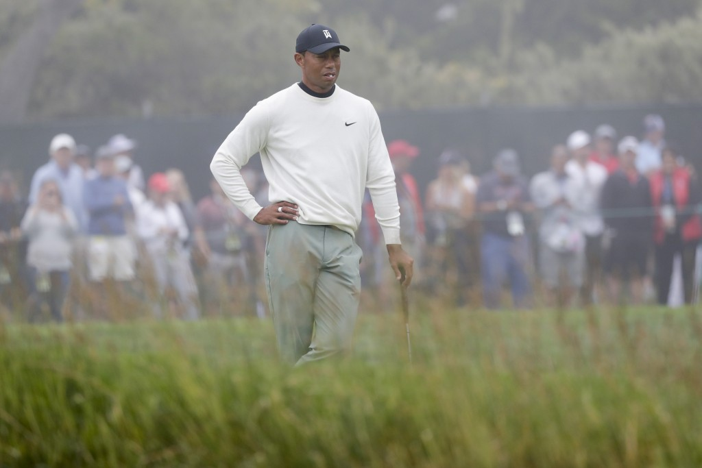 Tiger Woods waits to play the 16th hole during a practice round for the U.S. Open Championship golf tournament Wednesday, June 12, 2019, in Pebble Bea