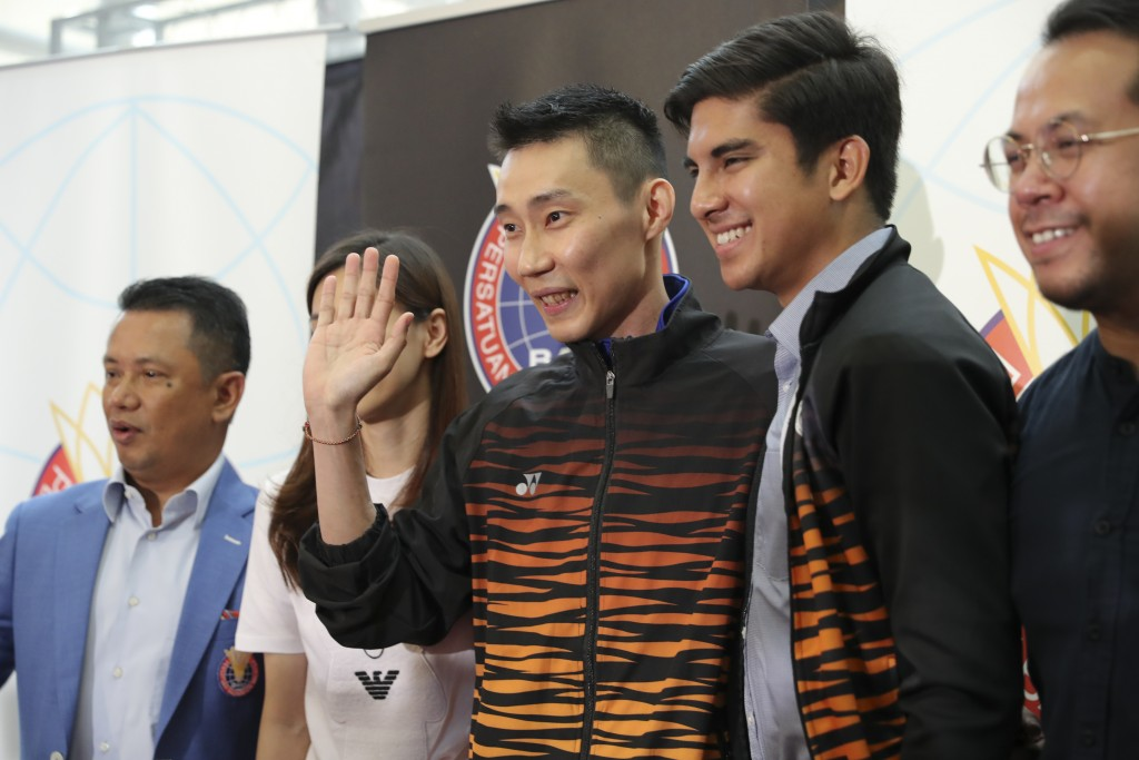 Malaysian badminton player Lee Chong Wei, center, waves to media after a press conference in Putrajaya, Malaysia, Thursday, June 13, 2019. Former Worl