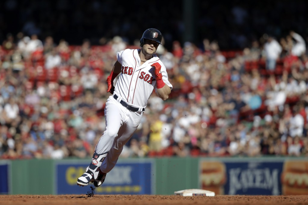 Boston Red Sox's Andrew Benintendi rounds second with an RBI-triple against the Texas Rangers in the third inning of a baseball game at Fenway Park, W...