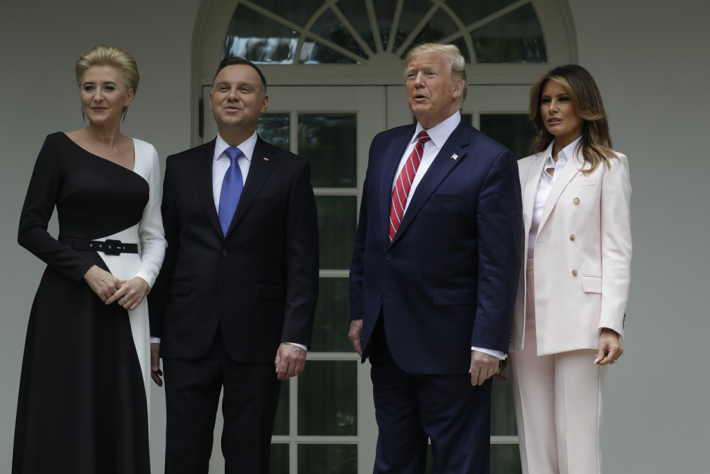 President Donald Trump and first lady Melania Trump stand for photographs with Polish President Andrzej Duda and his wife Agata Kornhauser-Duda outsid...