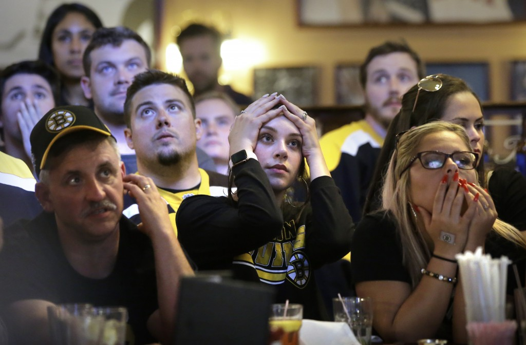Boston Bruins fans react as the St. Louis Blues score a goal, as the fans watch television coverage of Game 7 of the NHL hockey Stanley Cup Final on W