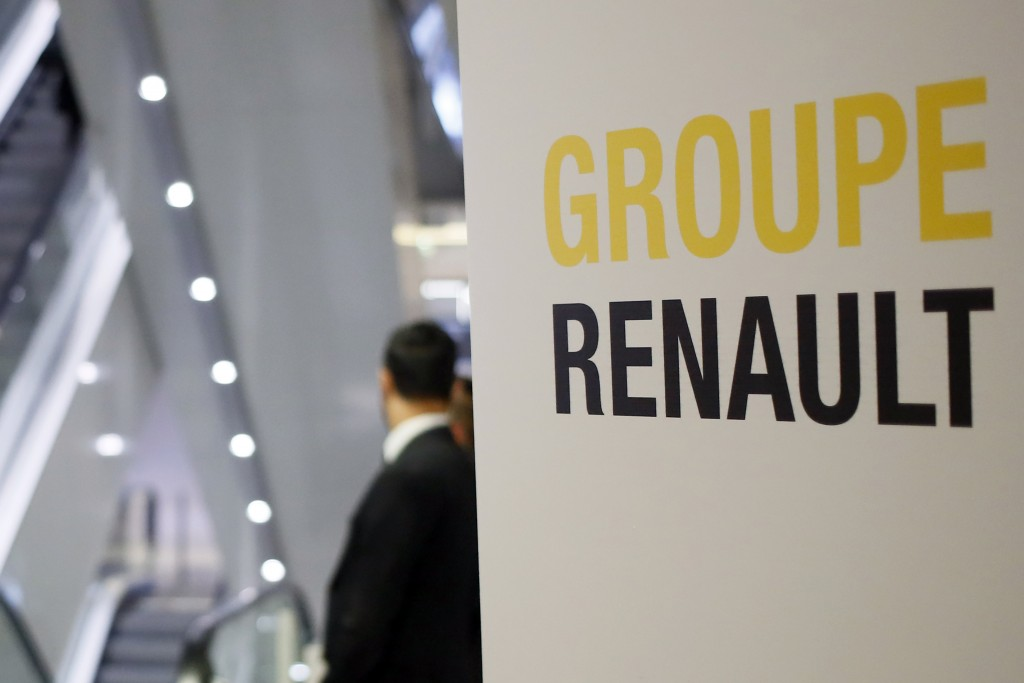 A sign of French automaker Renault Group shows the way for the Renault shareholders general meeting in Paris, France, Wednesday, June 12, 2019. (AP Ph