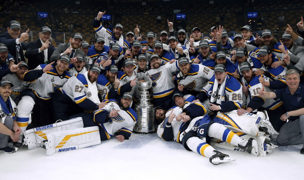 The St. Louis Blues celebrate with the Stanley Cup after they defeated the Boston Bruins in Game 7 of the NHL Stanley Cup Final, Wednesday, June 12, 2