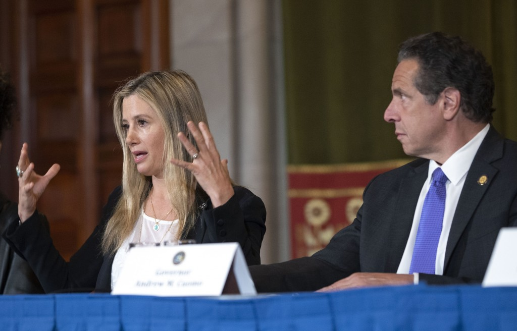 New York Gov. Andrew Cuomo, right, listens to Oscar-winning actress Mira Sorvino as she joined Times's Up advocates speaking out about sexual assault
