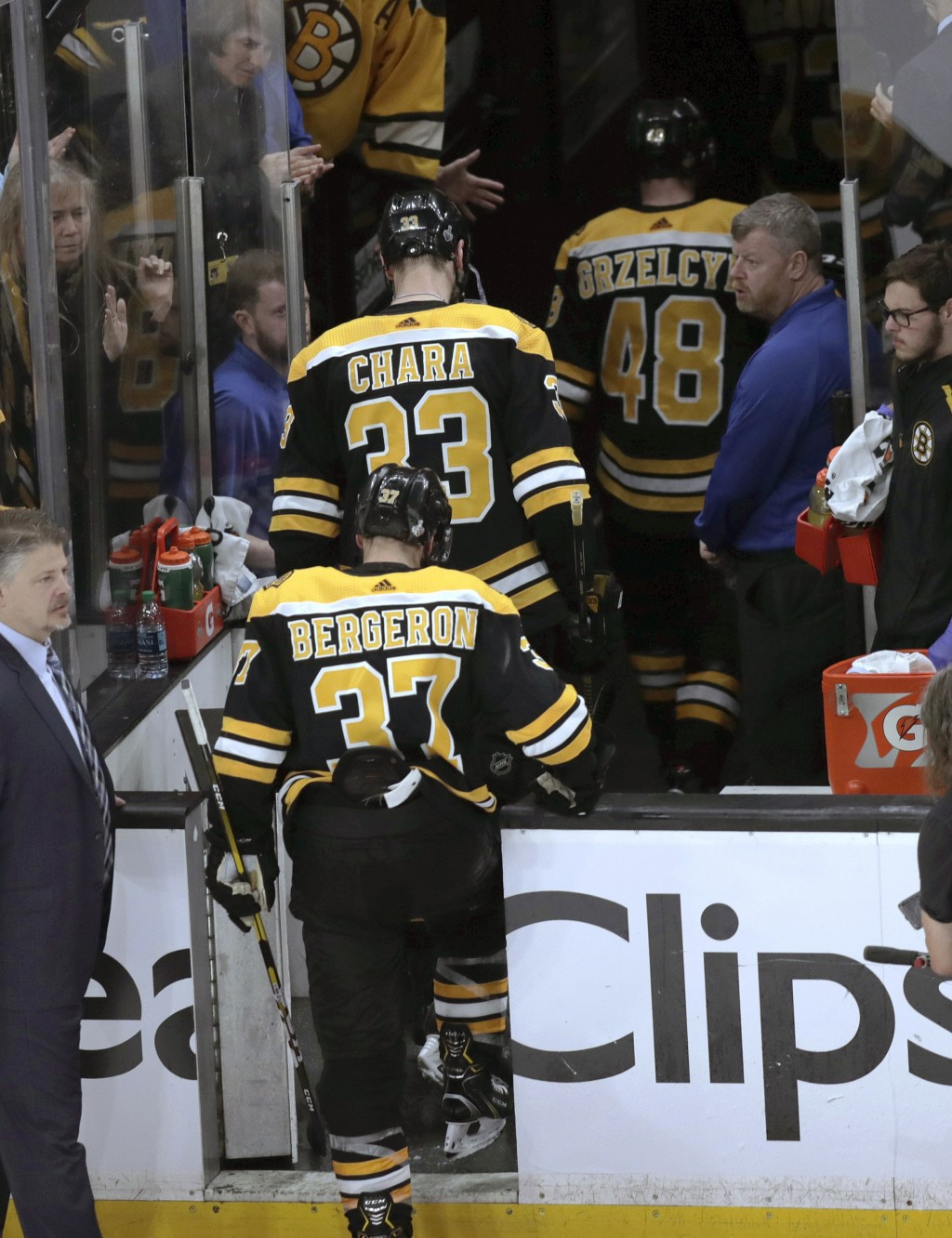 Boston Bruins' Patrice Bergeron (37), Zdeno Chara (33), of Slovakia, and Matt Grzelcyk (48) leave the ice after the St. Louis defeated the Bruins in G