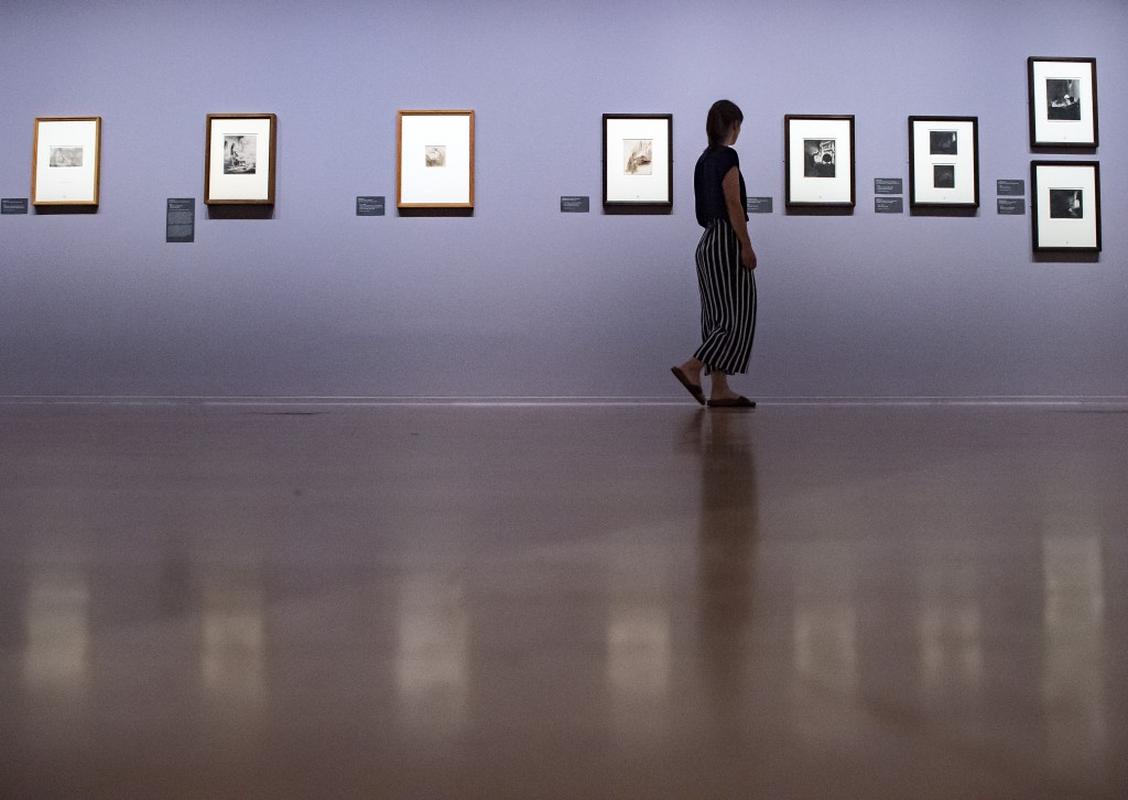 A woman walks through the exhibition rooms during a press preview of the 'Rembrandt's Mark' in Dresden, eastern Germany, Thursday, June 13, 2019. The