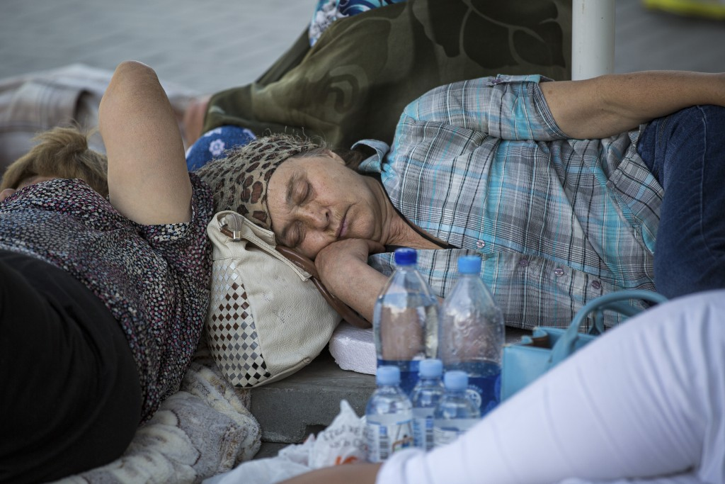 Supporters of the former government sleep outside the prosecutors office in Chisinau, Moldova, Wednesday, June 12, 2019. Moldova's police chief on Wed
