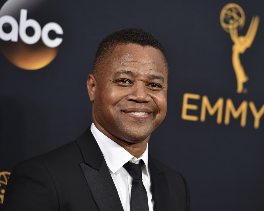 FILE- In this Sept. 18, 2016 file photo, Cuba Gooding Jr. arrives at the 68th Primetime Emmy Awards in Los Angeles. Gooding is expected to turn himsel