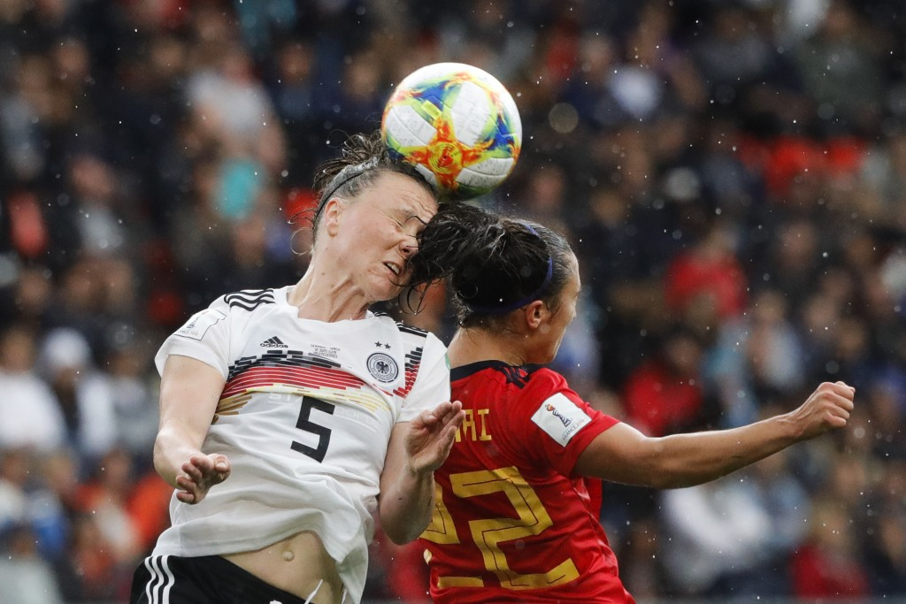 Germany's Marina Hegering, left, goes for a header with Spain's Nahikari Garcia during the Women's World Cup Group B soccer match between Spain and Ge