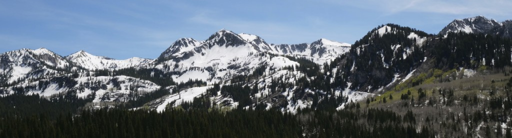This Tuesday, June 11, 2019, photo shows the snow covered Wasatch Range near Salt Lake City. The summer's melting snowpack is creating raging rivers t