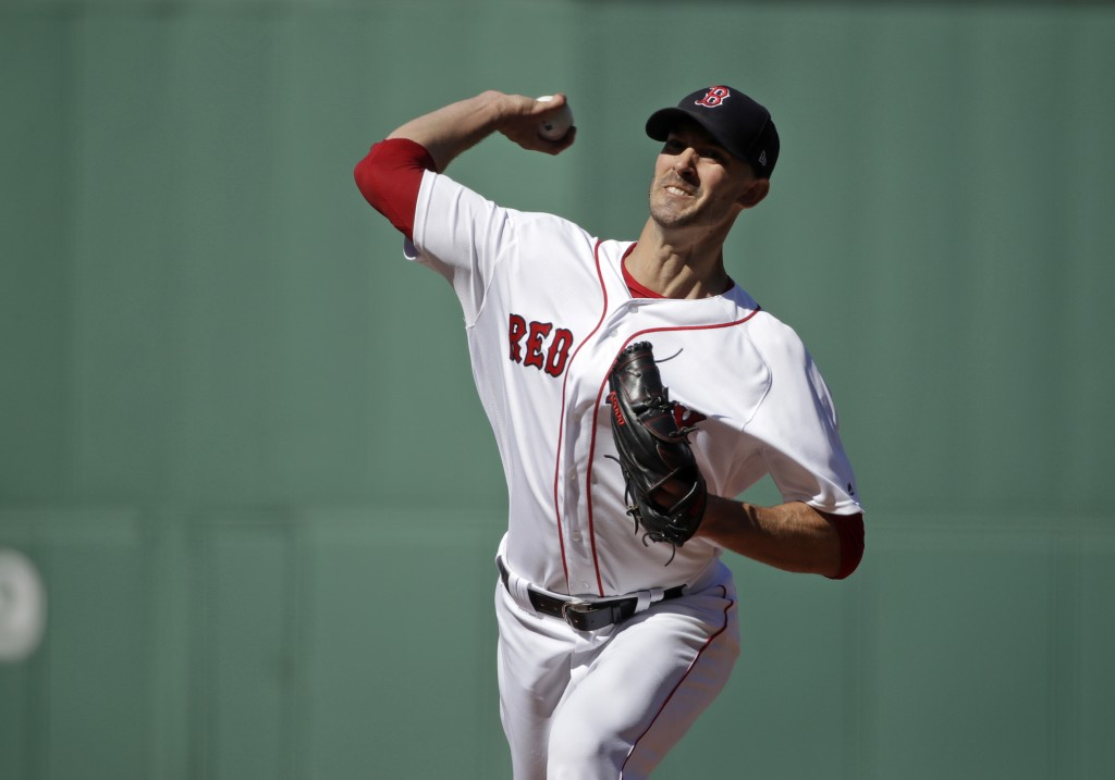 Boston Red Sox starting pitcher Rick Porcello delivers to the Texas Rangers in the first inning of a baseball game at Fenway Park, Wednesday, June 12,...