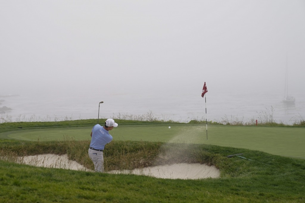Si Woo Kim, of South Korea, hits out of the bunker...