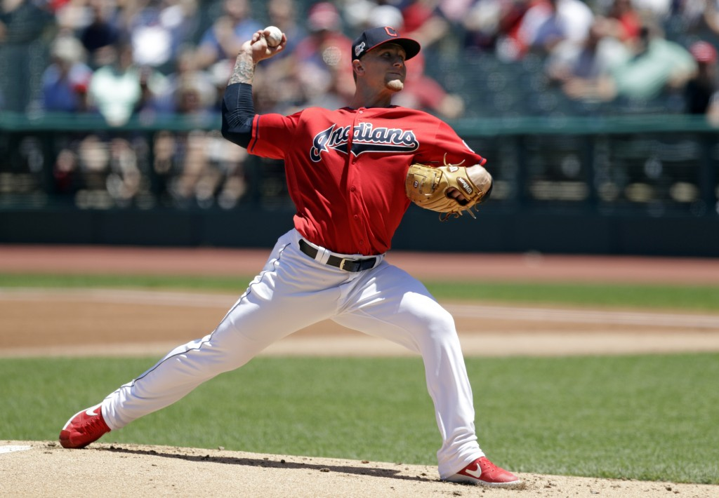 Cleveland Indians starting pitcher Zach Plesac delivers in the first inning in a baseball game against the Cincinnati Reds, Wednesday, June 12, 2019, ...