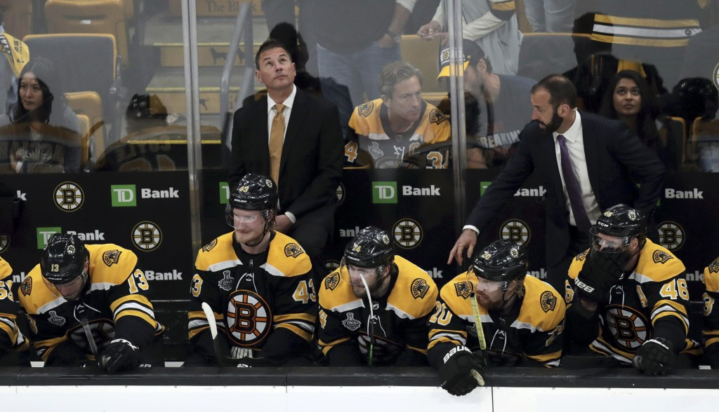 Boston Bruins head coach Bruce Cassidy checks the clock as time winds down during the third period in Game 7 of the NHL hockey Stanley Cup Final again