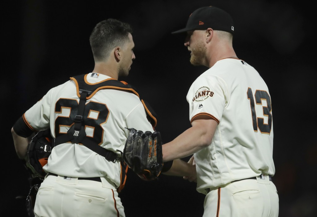 San Francisco Giants pitcher Will Smith, right, celebrates the team's 4-2 win over the San Diego Padres with catcher Buster Posey (28) after a basebal...