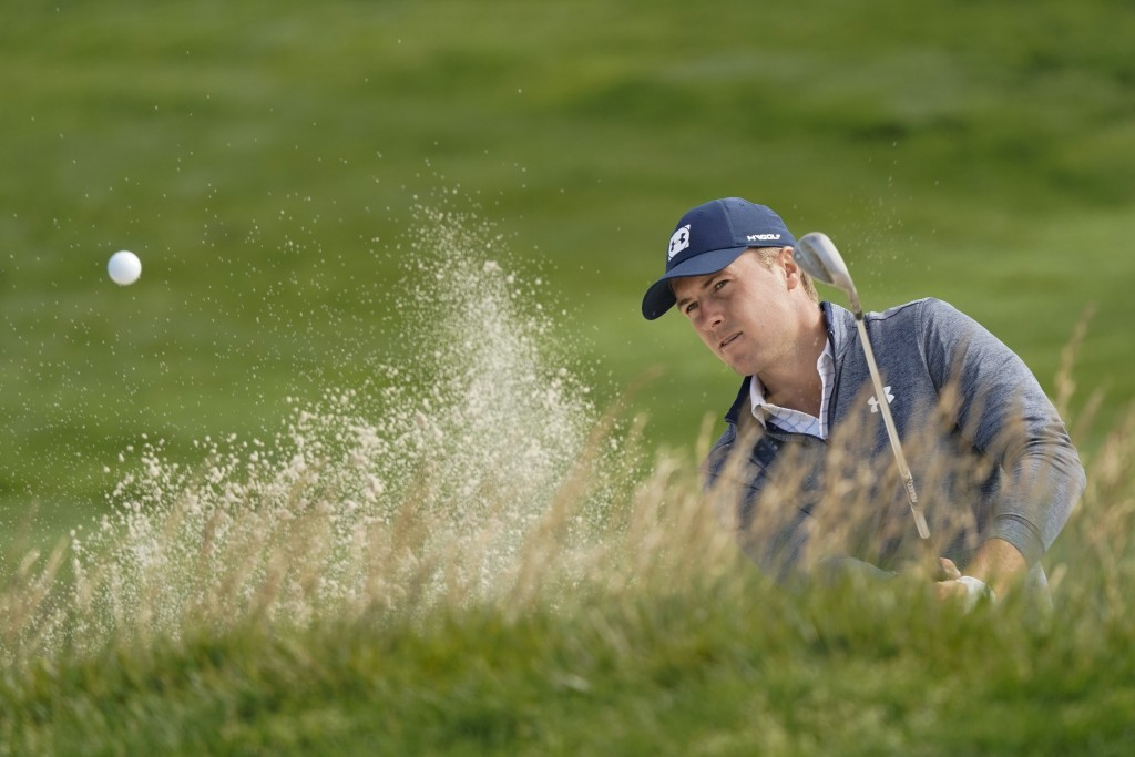 Jordan Spieth hits out of the bunker on the 10th hole during a practice round for the U.S. Open Championship golf tournament Wednesday, June 12, 2019,