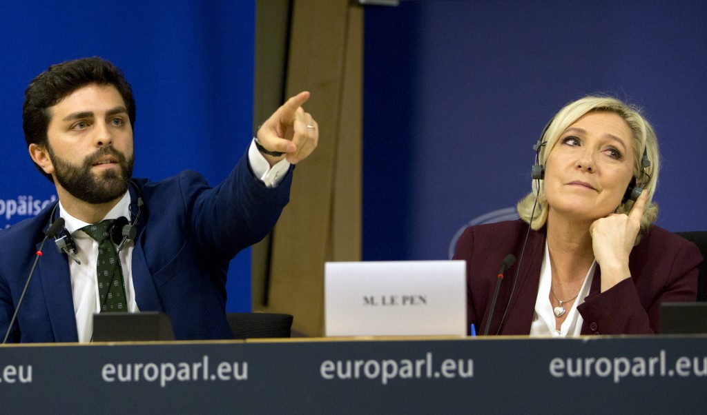 French far-right National Rally leader and MEP Marine Le Pen, right, and Italy's Lega party member and MEP Marco Zanni attend a media conference to an...