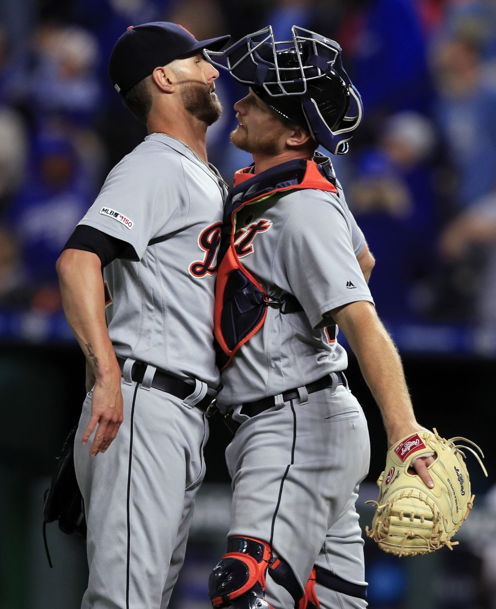 Detroit Tigers relief pitcher Shane Greene, left, and catcher John Hicks, right, celebrate following the team's baseball game against the Kansas City
