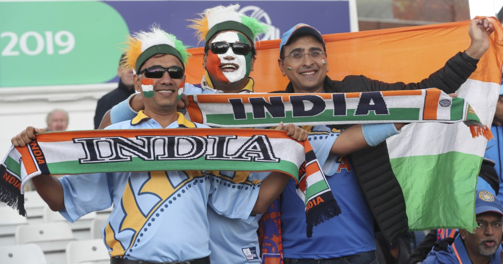 Indian fans cheer for their team after rain delayed start of the Cricket World Cup match between India and New Zealand at Trent Bridge in Nottingham,