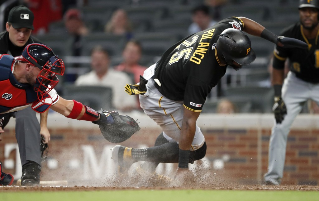 Pittsburgh Pirates' Gregory Polanco scores past the tag from Atlanta Braves catcher Tyler Flowers on a Corey Dickerson sacrifice fly during the sixth ...
