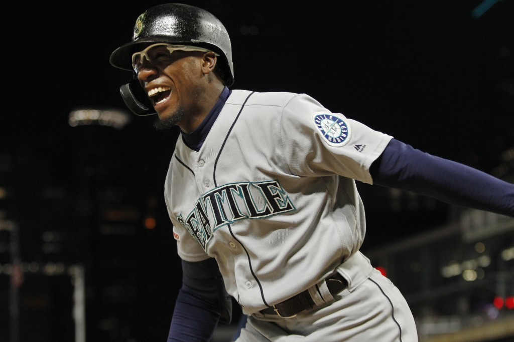 Seattle Mariners' Shed Long celebrates his three-run home run against the Minnesota Twins during the eighth inning of a baseball game Wednesday, June