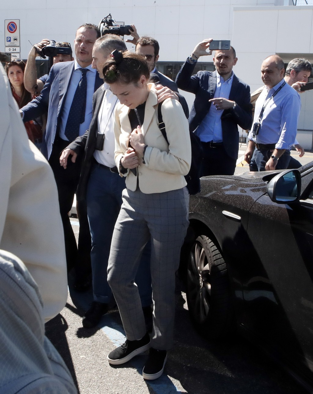Amanda Knox is approached by a journalist upon her arrival in Linate airport, Milan, Italy, Thursday, June 13, 2019. Knox has returned to Italy for th