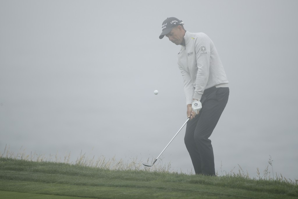 Henrik Stenson, of Sweden, hits a chip shot on the...