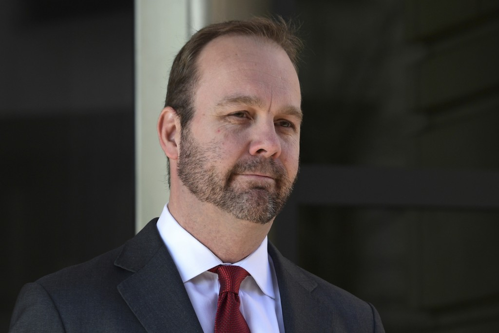 FILE - In this Dec. 11, 2017, file photo, Rick Gates, departs federal court in Washington. House intelligence committee has issued subpoenas for forme...