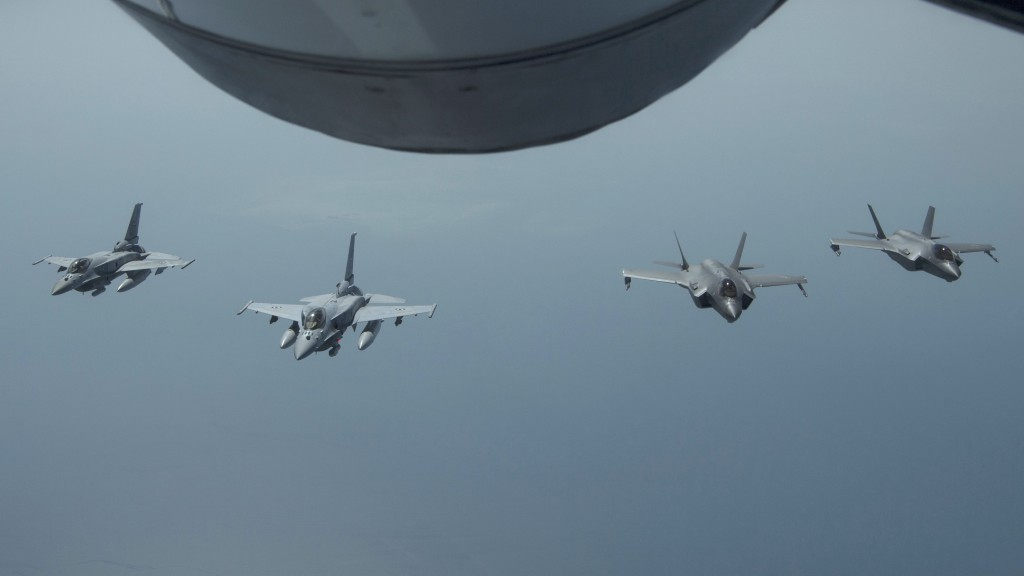 FILE - In this May 29, 2019 file photo released by the U.S. Air Force, United Arab Emirates Air Force Desert Falcons fly in formation with U.S. F-35A