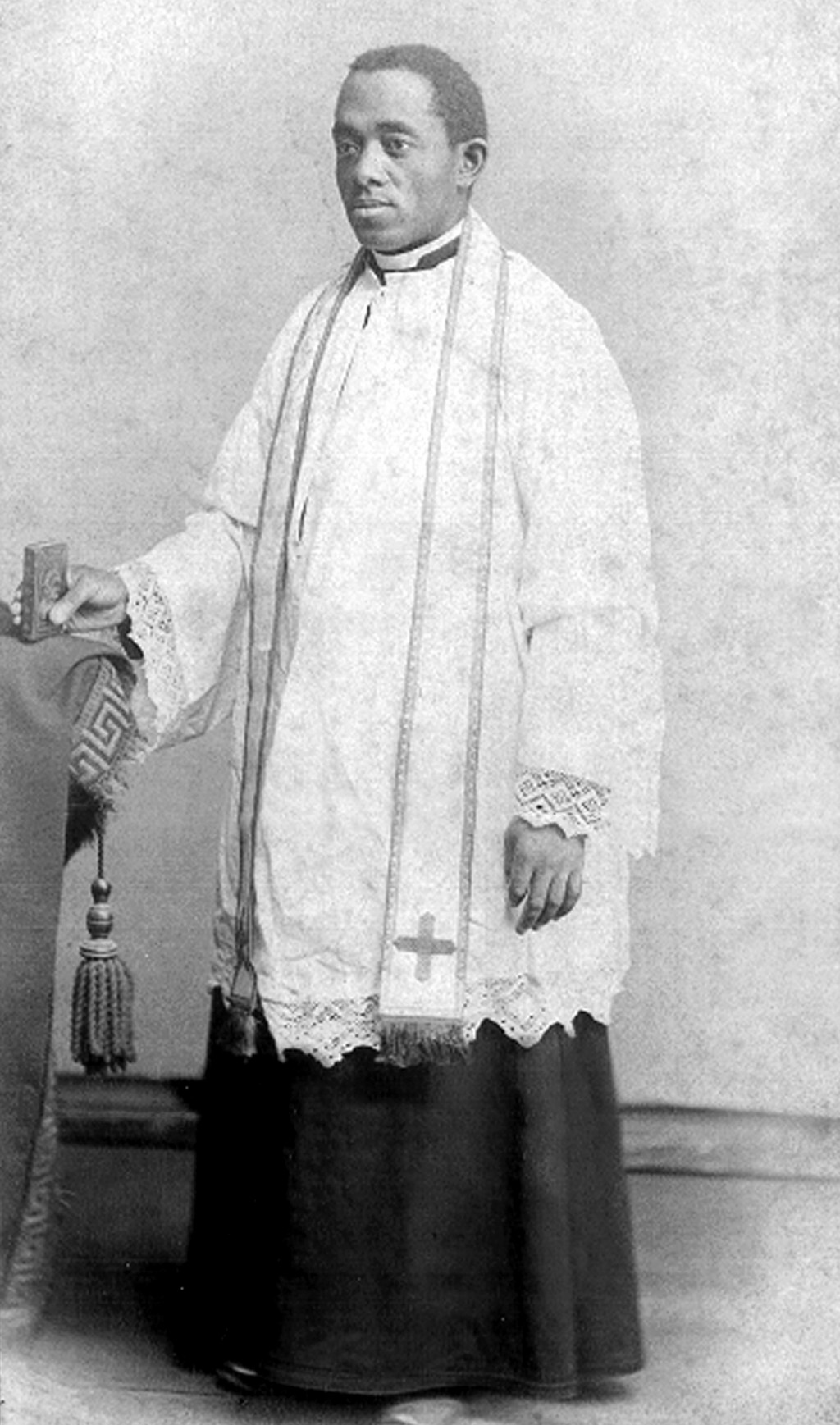 This 1886 photo courtesy of the Brenner Library, Quincy University in Quincy, Ill., shows Quincy's Father Augustine Tolton, following his ordination o...