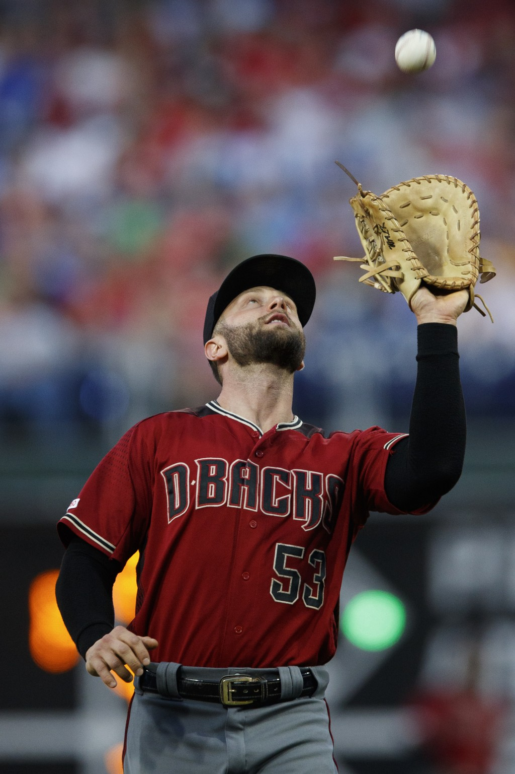 Arizona Diamondbacks first baseman Christian Walker catches a fly ball for the out on Philadelphia Phillies' Jean Segura during the fourth inning of a...
